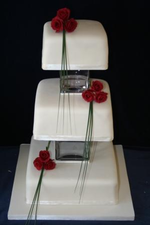 Cake with glass vases between tiers.JPG