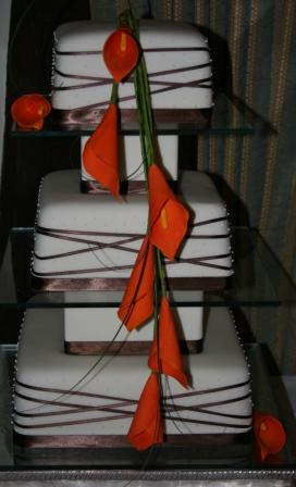Cake with calla lilies and ribbon wrapped round.JPG