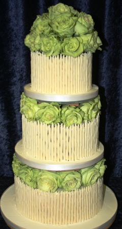 20141006-chocolate_cigarillo_wedding_cake_with_green_roses.jpg
