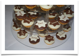 Chocolate and sponge cup cakes with white and milk chocolate paste tops and chocolate paste stars with the names of the guests piped on