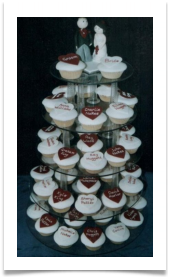 Cup cakes with guest's names.  Can be used for wedding cake or as favours and place settings - handmade sugar bride and groom